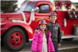 Kids in front of antique fire truck