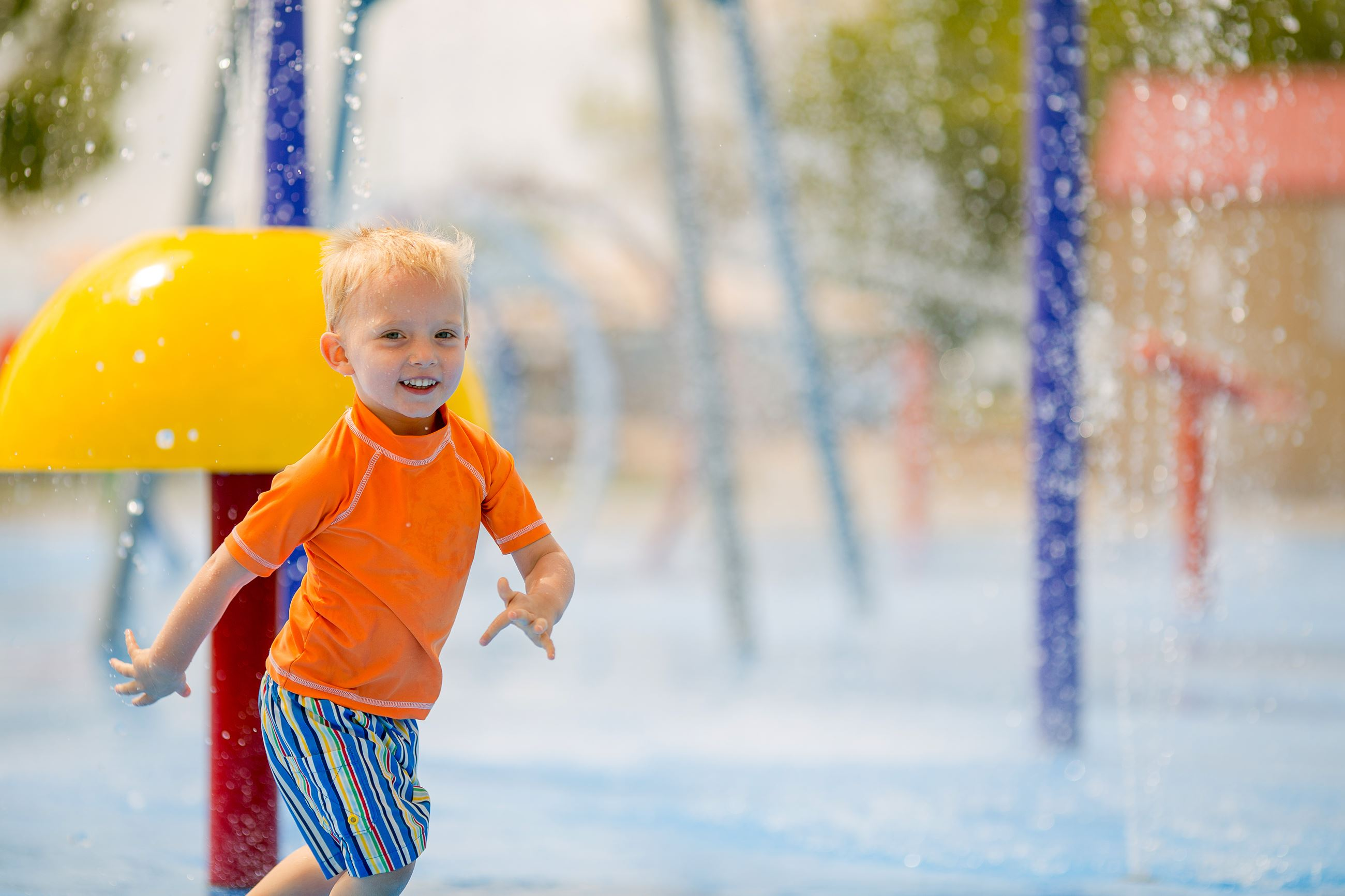 boy at splash park