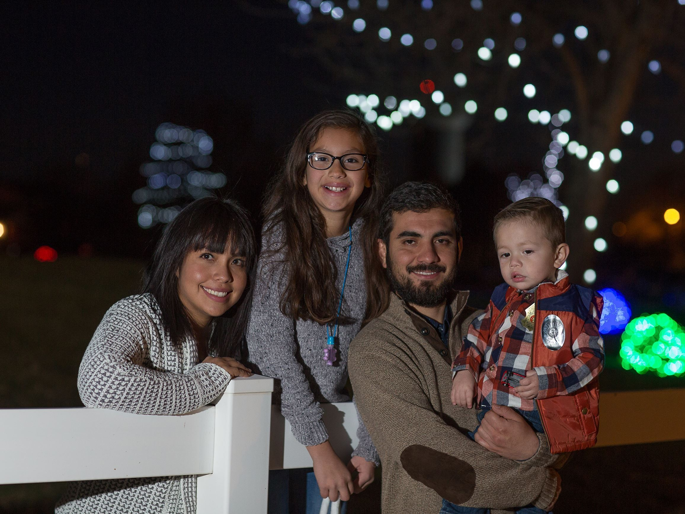 Family in front of lights